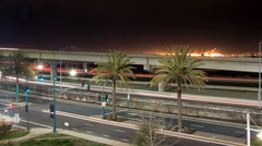 Time lapse of cars passing by on multiple levels of different roads and freeways - stock footage