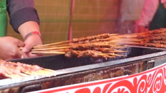 Mutton cubes roasted on a skewer, in Shenzhen, Baoan Food Festival, China. Stock Footage