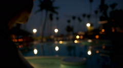 Woman tourist with pad on tropical resort in late evening - stock footage