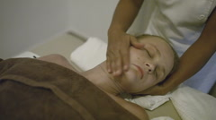 Young woman getting head massage at spa Stock Footage