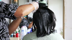 Woman dye hair. Stock Footage