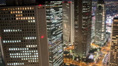 Night time lapse looking east over the famous high-rises of Shinjuku Tokyo Japan - stock footage