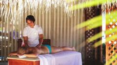 Spa treatment massage in gazebo Stock Footage