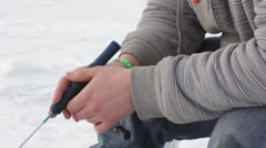 Ice Fishing Pan Down to Hole Stock Footage