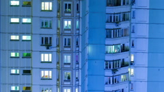 Timelapse of multistorey building with twilnkling lights in late evening Stock Footage