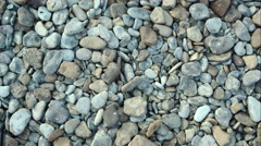 Male hand taking and throwing pebble stones Stock Footage
