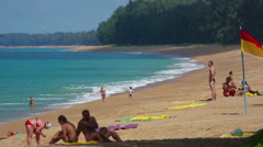 Mai Khao beach with people swimming Stock Footage