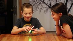 Children play with a Quadcopter Drone Stock Footage