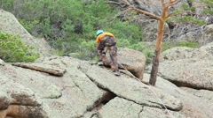 Climber preparing to descend the rock Stock Footage