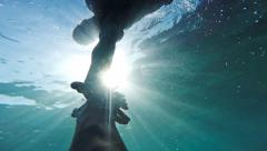 Savior Rescuer Salvation Hand Man Drowning Saved By Lifeguard Underwater Sun - stock footage