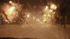 Snow melts on the windshield. Night deserted street Stock Footage