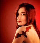 girl with bat tatoo - stock photo