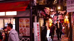 Tokyo, japan - march 31, 2014: people walk down a narrow restaurant-lined all Stock Footage