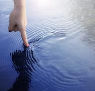 Finger and water Stock Photos