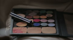 Make-up brush on colorful cosmetic palette Stock Footage