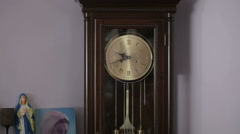 Old antique clock with statuette of the Virgin Mary Stock Footage