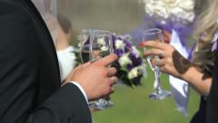 People communicate on a banquet with glasses in hands. Close up - stock footage