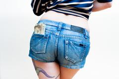 Sexy woman body part model with dollars in short jeans Stock Photos