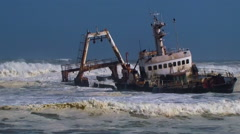 Shipwreck in waves Skeleton Coast Namibia Africa Stock Footage