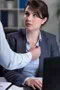Secretary being intimidated by chief Stock Photos