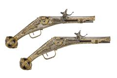 pair old antiques wheelock & flint pistols with clip path - stock photo