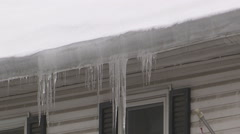 Ice and snow weather damage to eavestrough - stock footage
