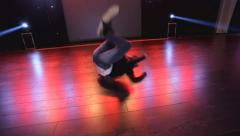 Hip-hop dancer  dances on stage in the club - stock footage