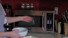 Women using microwave Stock Footage