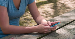 Hands of female texting outdoors 4k Stock Footage