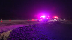 Car accident at night in snow storm on slippery road Stock Footage