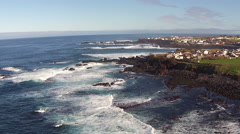 Flying over the Rocks and Ocean Waves Stock Footage