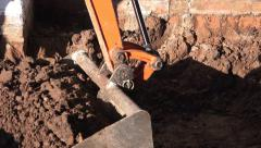 Stock Video Footage of building construction mini digger excavating soil