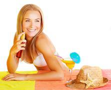 Sexy woman using sunscreen Stock Photos