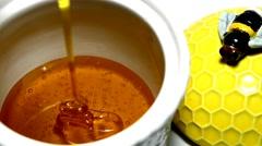 Honey running into a pot Stock Footage