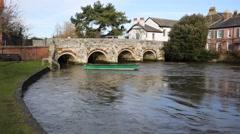 Stock Video Footage of River Avon Christchurch Dorset England UK with bridge flowing towards camera