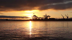 Shipping port at sunrise Stock Footage