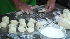 Roll the dough making and Boiled dumplings steamed stuffed bun Stock Footage