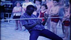 1633 - limbo game at tourist resort - vintage film home movie - stock footage