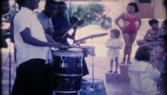 1632 - calypso band performs for tourist at resort - vintage film home movie - stock footage
