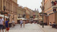 People in Vilnius street in the old town of Kaunas, summer, editorial  Stock Footage