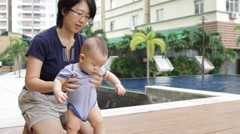 baby learning how to stand - stock footage