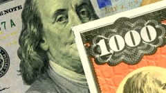 United States $100 bills and $1000 savings bonds. - stock footage
