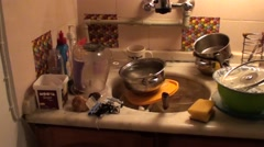 Clutter of dirty dishes panning Stock Footage