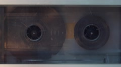 Stock Video Footage of Old-style audio tape cassette playing 4K
