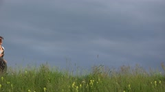 Stock Video Footage of Beautiful woman running on spring hill, close to dramatic sky, joy scenery 4K