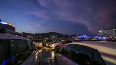 Time lapse of cars moving in parking lot at airport in evening. Stock Footage