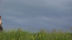 Stock Video Footage of Beautiful woman running on spring hill, close to dramatic sky, joy scenery
