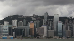 Time lapse extreme close up Hong Kong Skyline dark clouds Stock Footage