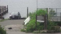 Car Parked In Harbor Lake Kawaguchi Japan 4K Stock Footage