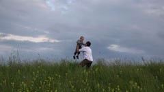 Gorgeous view, father rise up his son to dramatic sky  Stock Footage